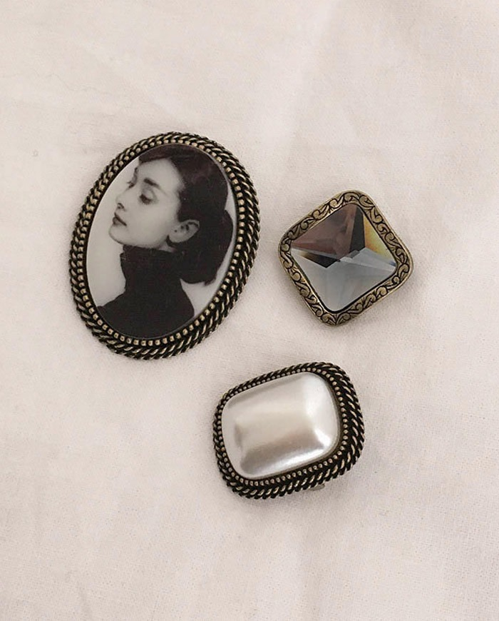 Audrey Hepburn brooch set